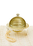 Vintage bonbon dish with pearls. Old silver bonboniere with pearls sitting on vintage handmade lace. Isolated over white. This image is exclusive to DT Royalty Free Stock Image