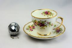 Vintage Bone China Tea Cup and Saucer 4. Vintage bone china tea cup and saucer with infuser. Good companion for an afternoon tea royalty free stock photography