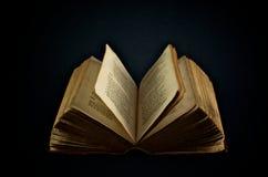 Vintage Book. A vintage weathered old book on black background Stock Image