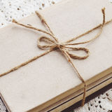 Vintage book bundle tied up with jute twine on lace doily Stock Photo