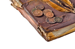 Vintage book with copper coins Stock Photo