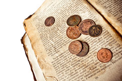 Vintage book with copper coins Royalty Free Stock Photography