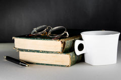 Vintage book and a cup of coffee Stock Photos