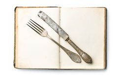 Vintage book and cutlery Royalty Free Stock Photos