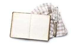 Vintage book and cutlery Stock Photos