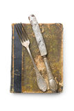 Vintage book and cutlery Stock Images