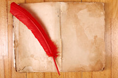 Vintage Book with feather pen Stock Photography