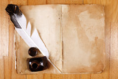 Vintage book with feather pen Royalty Free Stock Image