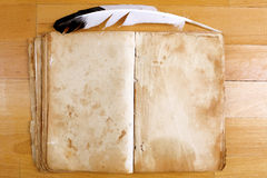 Vintage Book with feather pen Stock Photo