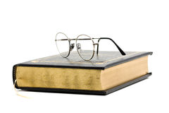 Vintage book with glasses Royalty Free Stock Photography