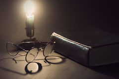 Vintage book with glasses Stock Images