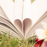 Vintage book heart shape, dept of field. Royalty Free Stock Image