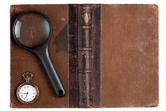 Vintage book with magnifying glass Stock Image