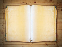 Vintage book on old wooden background clipping path. Royalty Free Stock Image