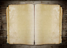 Vintage book on old wooden background clipping path. Stock Photography