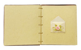 Vintage book open with envelope Stock Images
