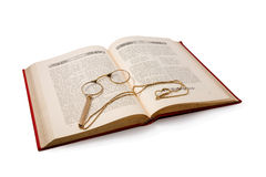 Vintage book and pince-nez. Isolated on white. Royalty Free Stock Photo