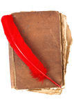 Vintage book with red feather Stock Photos