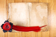 Vintage Book with red feather pen Stock Image