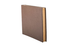 Vintage book with thick pages and brown cover on white backgroun Royalty Free Stock Photography