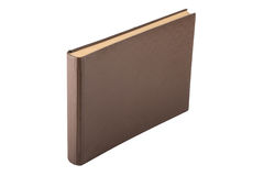 Vintage book with thick pages and brown cover on white backgroun Stock Images