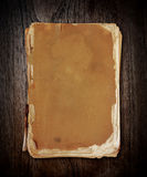 Vintage book on wood with clipping path. Royalty Free Stock Photo