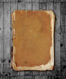Vintage book on wood with clipping path. Stock Photos
