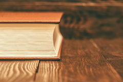 Vintage book on wooden background Royalty Free Stock Photography