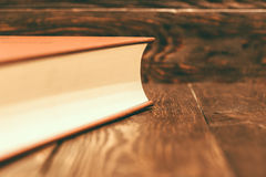 Vintage book on wooden background Royalty Free Stock Images
