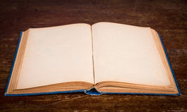 Vintage book on wooden background Stock Photos