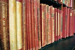Vintage book on the wooden bookshelves stock images
