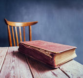 Vintage book on a wooden table Stock Image