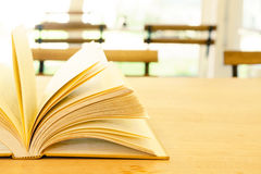 Vintage book on wooden table Stock Photo