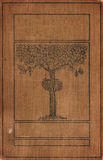 Vintage bookcover with Tree. A distressed vintage book cover with a tree illustration. The words of the title have been removed to allow designers to add their Royalty Free Stock Photography