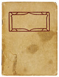 Vintage Booklet. An old booklet viewed from above. The yellowing cover is water stained and creased with rough edges and dog-eared corners and is blank except Royalty Free Stock Images