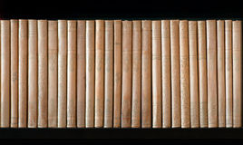 Vintage books. Row of vintage beige dirty books in  bookcase Royalty Free Stock Image