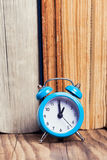 Vintage books and an alarm clock Royalty Free Stock Photos
