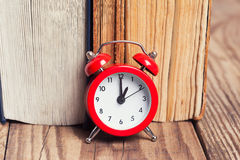 Vintage books and an alarm clock Stock Photo