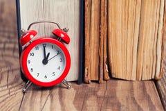 Vintage books and an alarm clock Stock Photos