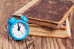 Vintage books and an alarm clock Stock Photography