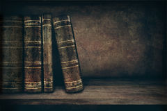 Vintage  books. Vintage background with old books on a shelf and copy space Stock Photos