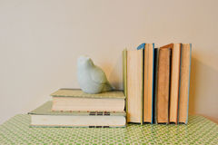 Vintage Books with Bird Figure Stock Images