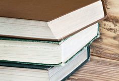 Vintage books on the brown bookshelf Stock Photos