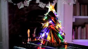 Vintage books Christmas tree and open fire. stock footage