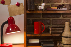 Vintage books coffee cup and desk lamp on the table. Royalty Free Stock Image