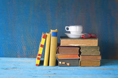 Vintage books with coffee cup and specs Stock Photos