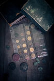 Vintage books and coins on old wooden table. Toned Royalty Free Stock Photography