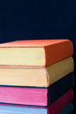 Vintage books with colored spines and pages Stock Photos