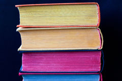 Vintage books with colored spines and pages. Stock Photography