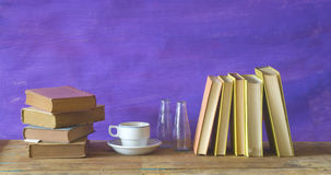 Vintage books with a cup of coffee Stock Images